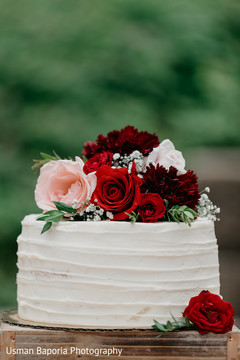 Detail of the Indian wedding cake and floral decorations