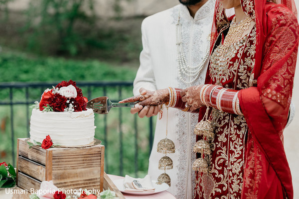 Beautiful moment between the maharani and Indian groom cutting the cake