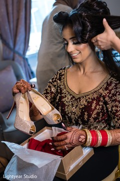 Indian bride admiring her shoes