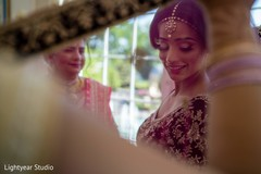 Indian bride putting her dupatta on