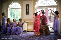 Indian bride getting ready with her mother and bridesmaids