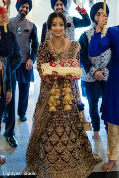 Happy indian bride walking down the aisle