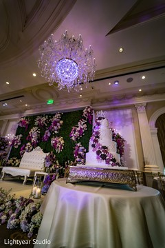 Lovely indian wedding cake matching with backdrop
