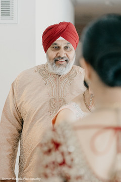 Father stares at the beautiful Maharani prior to the Indian wedding