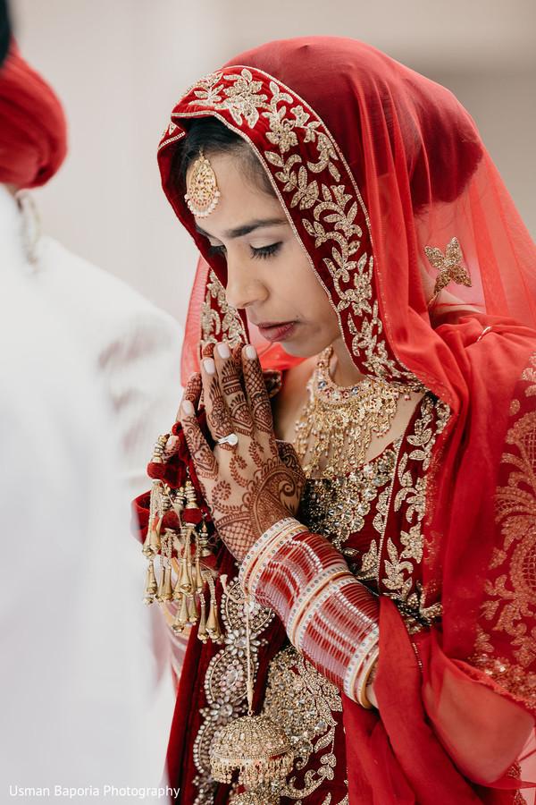Maharani prays during the Indian wedding ceremonies