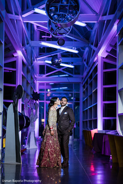 Indian newlyweds have a tender moment under the light decoration