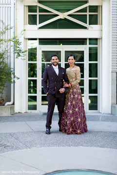 Elegant Indian newlyweds outside for pictures