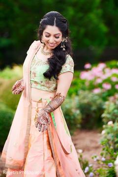 Indian bride showing her mehndi designs