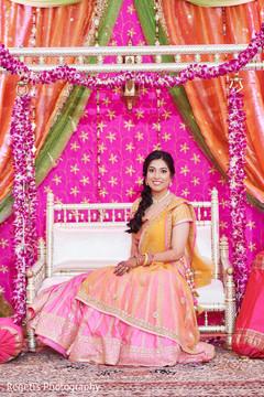 Indian bride sitting at jhula