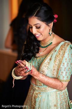 Maharani putting on her bangles