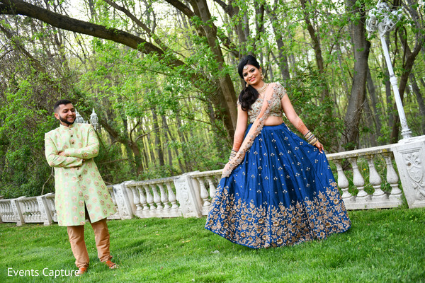 Ravishing Indian bride and grooms out in a garden capture.