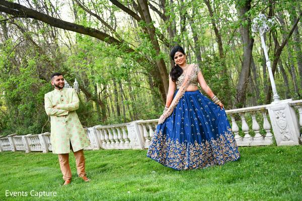 Charming Indian bride and groom pre-wedding sangeet fashion look.