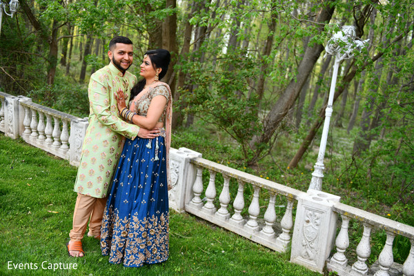 Lovely Indian couple on their sangeet outfits.