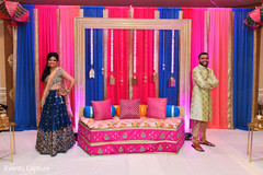 Indian bride and groom enjoying posing at the sangeet stage.