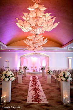 Stunning Indian wedding aisle petals and flowers decoration.