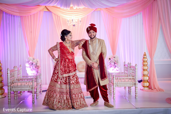 Indian bride and groom in traditional wedding dress.