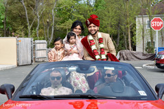 Indian groom arriving with family to wedding ceremony.