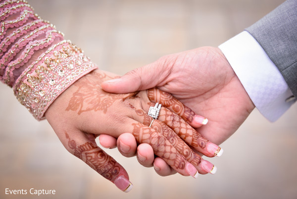 Sweet shot of Indian couple holding hands closeup.