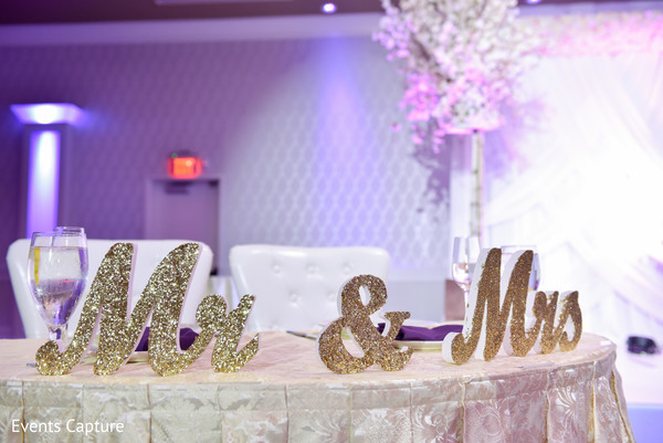 Marvelous Indian bride and groom's reception table decor.