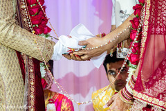 Indian bride and groom during wedding ceremony ritual.