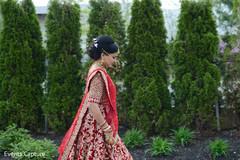 Adorable Indian bride walking outdoors.