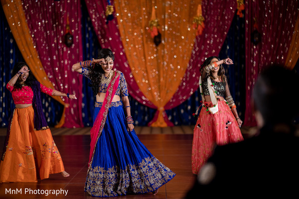 Gorgeous maharani performing a choreography during the pre wedding rituals