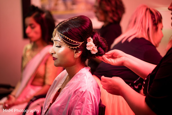 Beautiful maharani being assisted with the hair and makeup