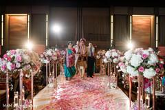 Floral arrangement detail as the Indian groom walks down the aisle
