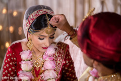 Indian bride wearing the tikka prior the ceremony