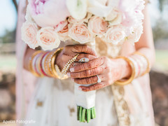 Indian bride holding her bouquet