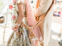 Detail of the Sari and Sherwani worn by the newlyweds