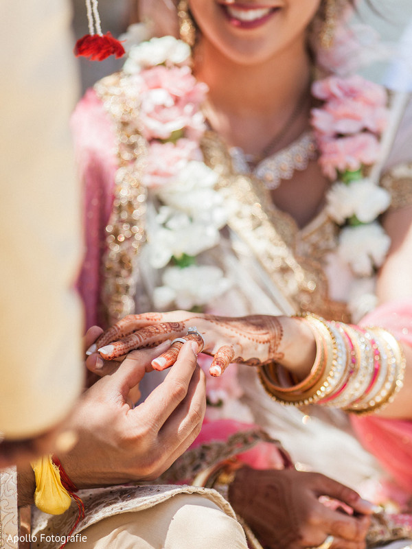 Indian bride receiving her wedding ring