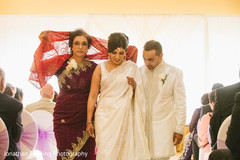 Dazzling indian lovebirds walking out their wedding ceremony.