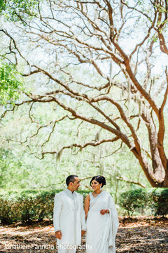 Stunning Indian bride and groom outdoors photo.