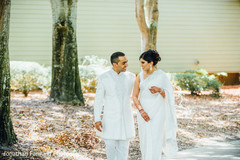 Adorable Indian couple walking outdoors.