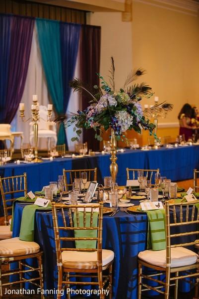 Beautiful Indian wedding reception table floral centerpiece.