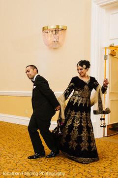 Marvelous indian love birds portrait  dancing in to their wedding reception.