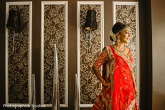 Adorable Indian bride ready for wedding ceremony.