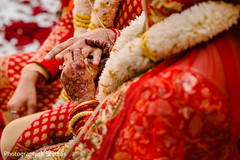 Indian bride and groom  exchanging rings.