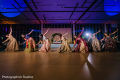Joyful Indian bridesmaids dance performance.