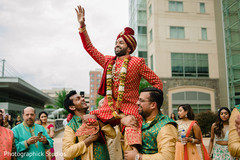Indian groomsmen celebrating with groom the baraat.