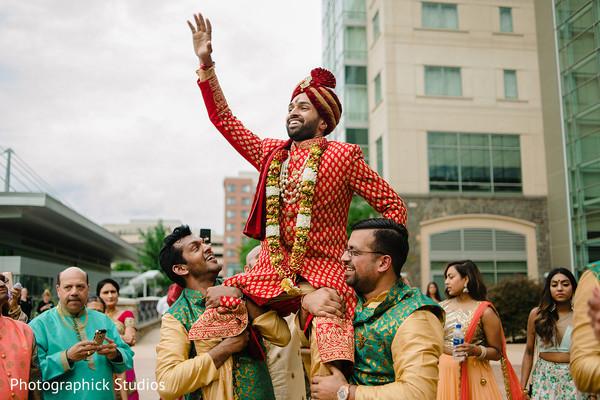 Indian groomsmen celebrating with groom the baraat.