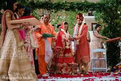 Rajaham ritual where bride and groom throw the rice on sacred fire.