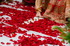 Indian bride and groom touches with toe seven nuts or betel.