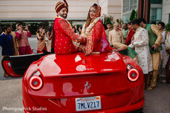 Joyful Indian bride and groom out of wedding ceremony capture.