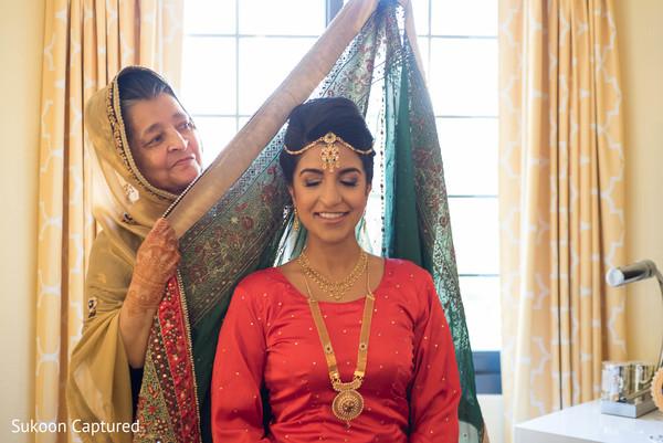 Gorgeous Indian bride getting her wedding ghoonghat.