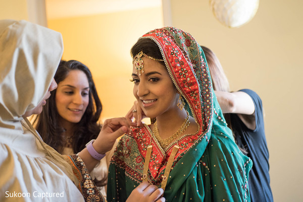 Dazzling Indian bride getting her jewelry on.