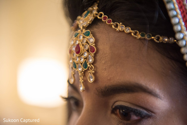 Magnificent Indian bridal tikka closeup capture.