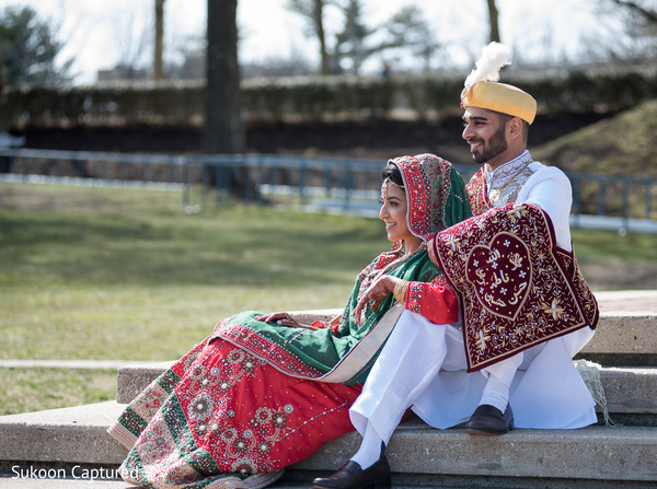 Sweet Indian bridal and groom's first look scene.