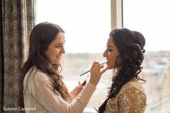Beautiful Indian bride getting ready for wedding reception.